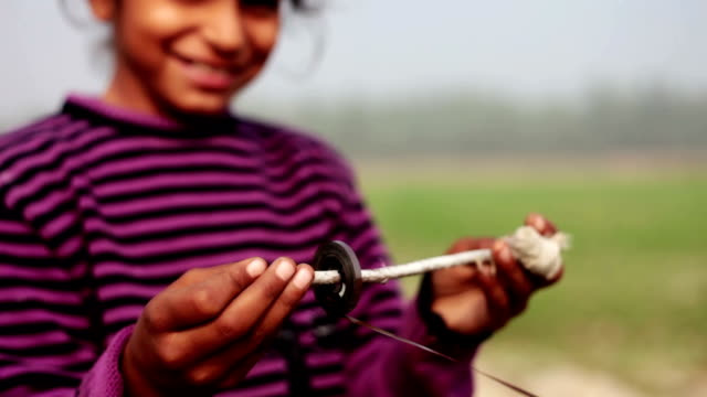Little girl playing with audio cassette. Little girl of Indian ethnicity playing with audio cassette outdoor in the nature. haryana stock videos & royalty-free footage