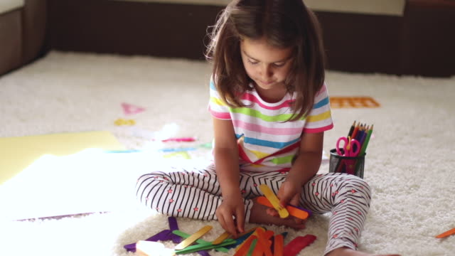 Little girl playing with colorful objects