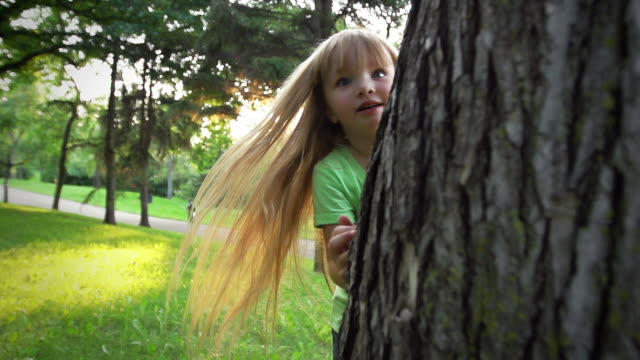Little girl plays hide and seek video