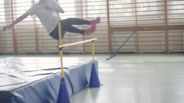 4K: Little Girl Practicing High Jump. video