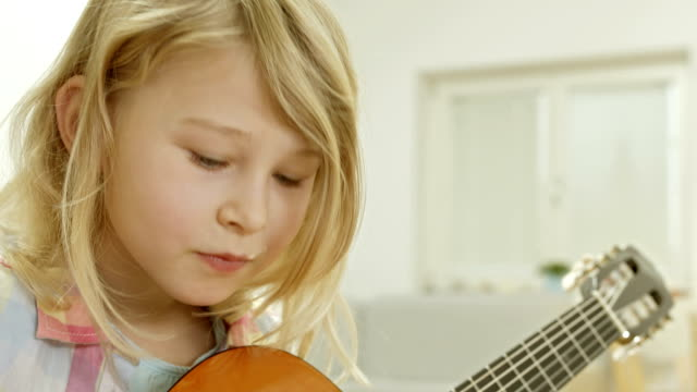 Little Girl Practicing Playing The Guitar video