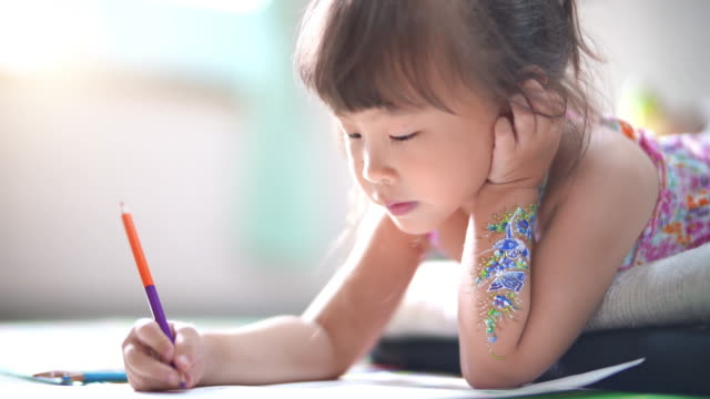 Little girl practicing writing at home video