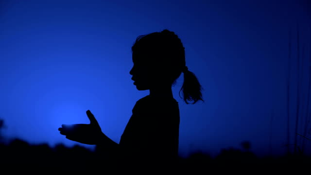 Little Girl Praying Silhouette HD1080p: Little Girl Praying Silhouette During Sunset Outdoor Portrait. indian culture stock videos & royalty-free footage