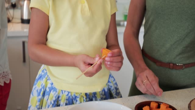 Little Girl Preparing Food with Mum video