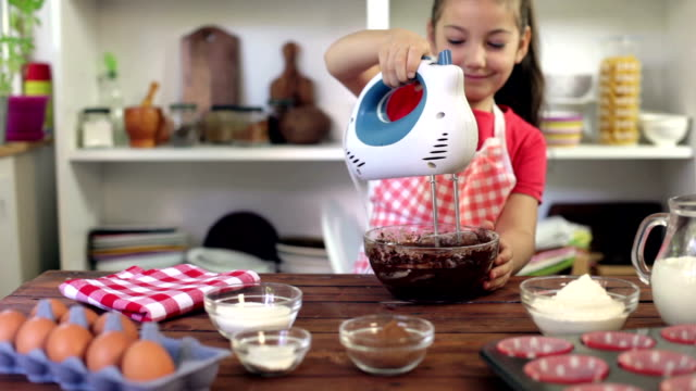 Little Girl Preparing Muffins video