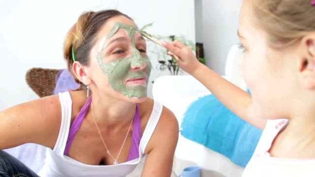 little girl puts mud face mask on mom - facial stock videos & royalty-free footage