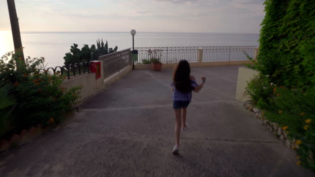 little girl run, the sunset on the sea, italy,lookout, calabria , summer,tropea - video di tropea video stock e b–roll