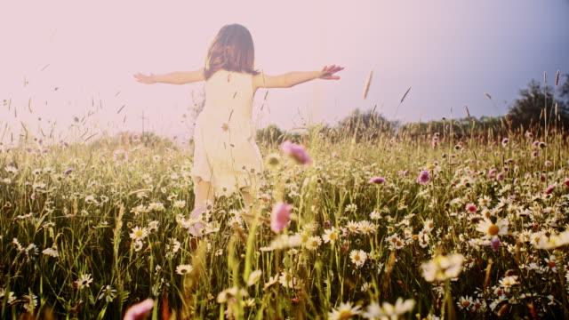 SLO MO Little girl running through meadow video