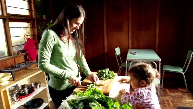 Little Girl runs to Help Mother make healthy Food video