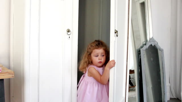 Little girl scared and hiding in the wardrobe video