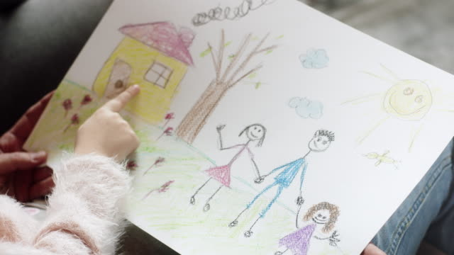Little girl showing drawings to her parents video