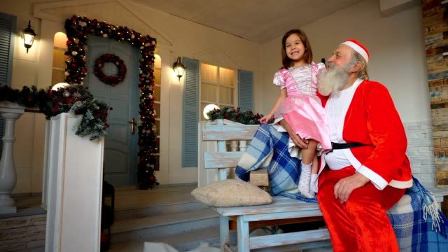 Little girl singing with Santa Claus video
