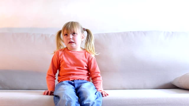 Little girl sitting on couch and crying, mother screaming at child for bad behavior Little blonde girl sits on light sofa and cries, parents have punished for bad behavior. Daughter upset and shamed, tears shine in eyes, child promises to be obedient. Concept of ability to find common language with children, or importance of supporting relatives in difficult situations, in ability to establish family relationships. obedience stock videos & royalty-free footage