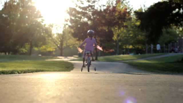 Little Girl Slowly Rides Her Bike To The Playground video