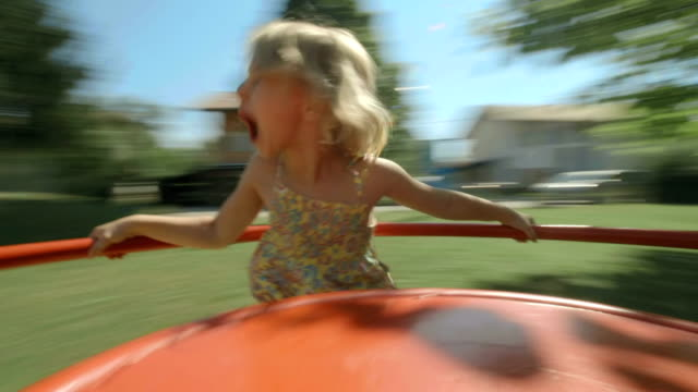HD: Little Girl Spinning On Playground Merry-Go-Round video