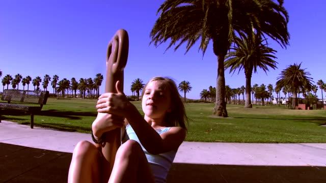 Little girl spins on playground spinner video