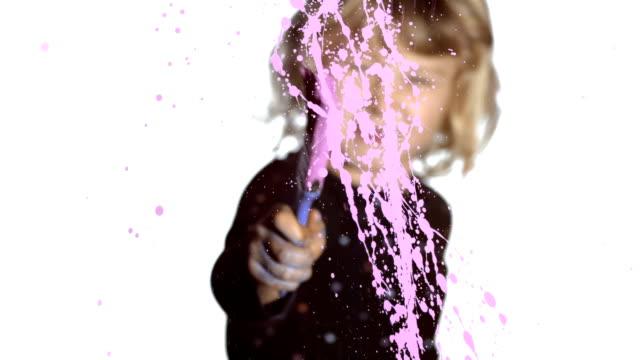 HD: Little Girl Splattering Paint On A Glass video