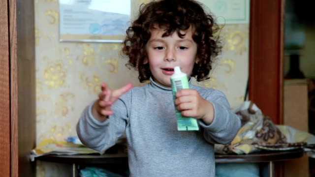 Little girl squeezing the cream tube video