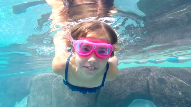 Little Girl Swimming Underwater in Swimming pool video