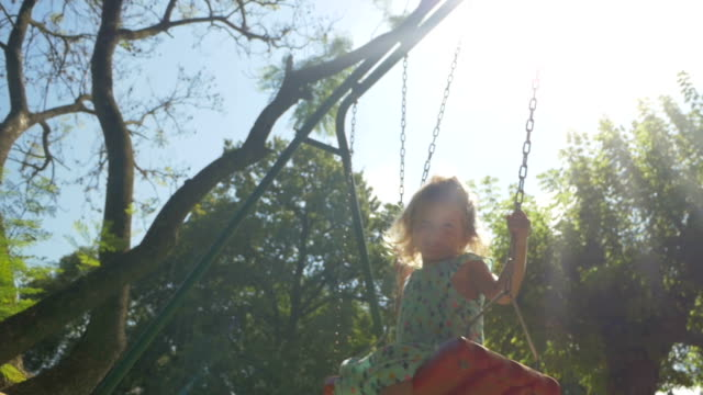 little girl swinging - brother stock videos and b-roll footage
