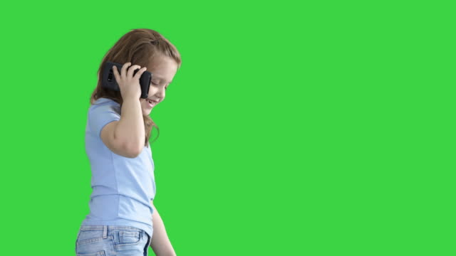 Little girl talk phone and walking on a Green Screen, Chroma Key