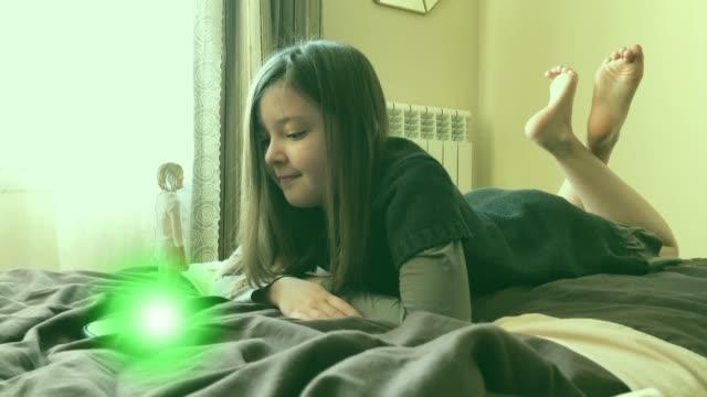 Little girl talking to hologram