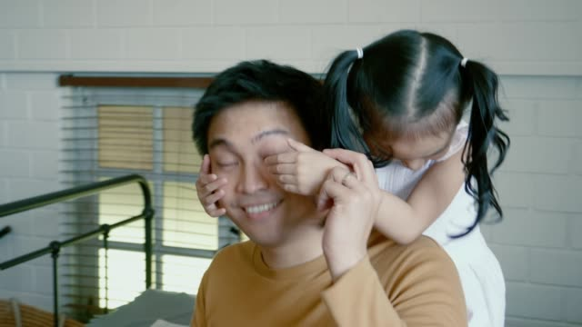 little girl teasing her father - two students together asian video stock e b–roll