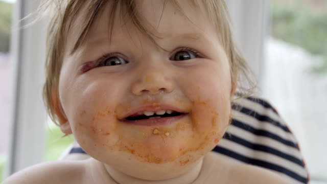 Little Girl Toddler Messy Eating In High Chair video