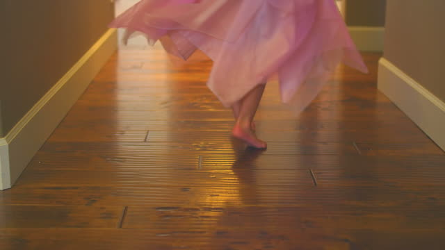 Little girl twirls and spins in hallway video