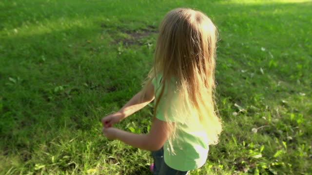 Little girl twirls video