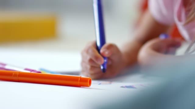 Little Girl Using Felt Tip Pens video