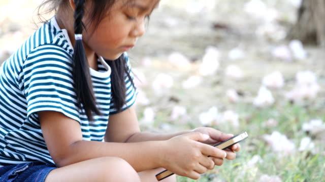 Little girl using phone video