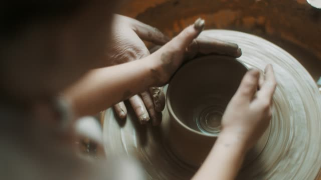 Little girl using pottery wheel at atelier video