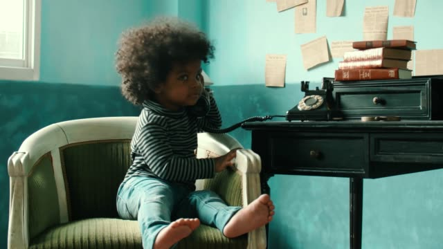 Little girl(2-3 Years) using rotary phone