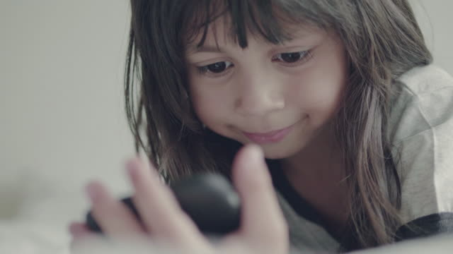Little girl (5 years) using smart phone at home video