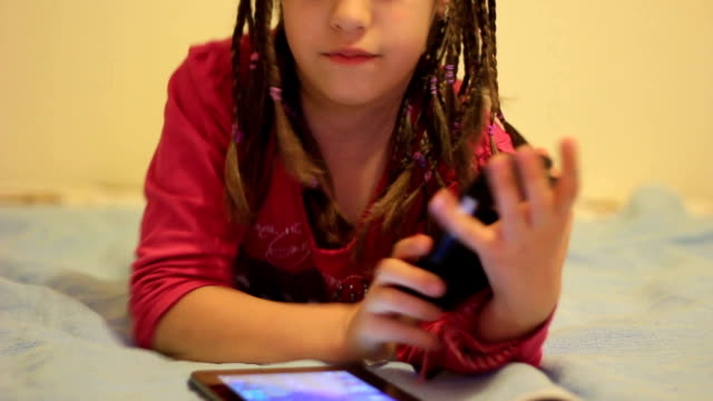 Little girl using tablet video