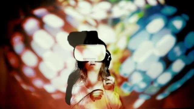 Little girl using VR-helmet. vr dance simulator video