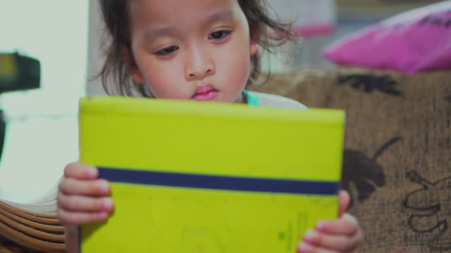 Little girl using with a digital tablet video