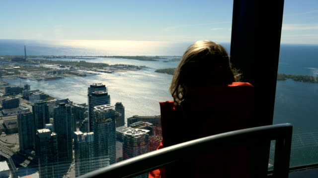 Little Girl Views Toronto's Downtown and Lake Ontario from a Bird's Eye View video
