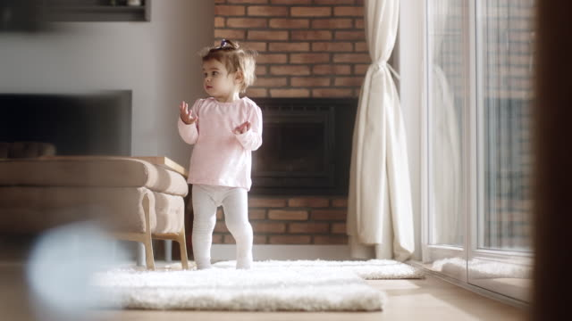 Little girl walking at living room video