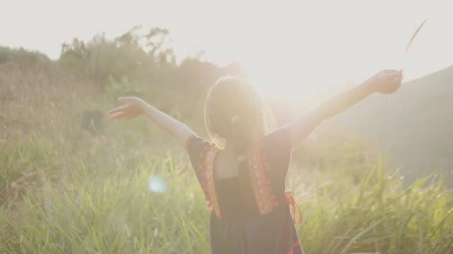 Little Girl Walking over the Hill Young Mixed Race Girl Walking over the hill with Gramineae Grass Field sideways beauty in nature stock videos & royalty-free footage