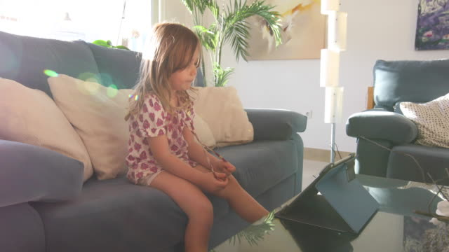 little girl watching tablet with sunbeam video