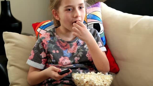 Little girl watching tv video