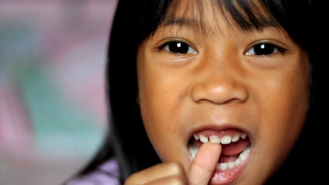 Little Girl Wiggling Her Loose Front Tooth video
