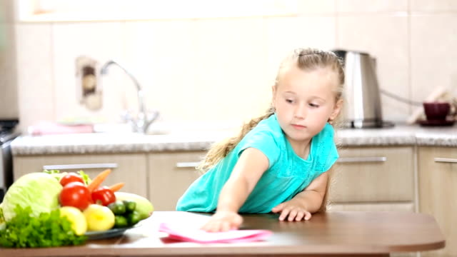 Little girl wiping the table Little girl wiping the table in the kitchen chores stock videos & royalty-free footage