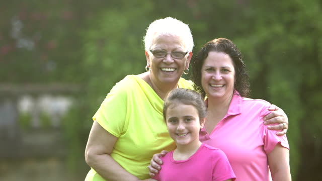 Little girl with mother and grandmother in park video