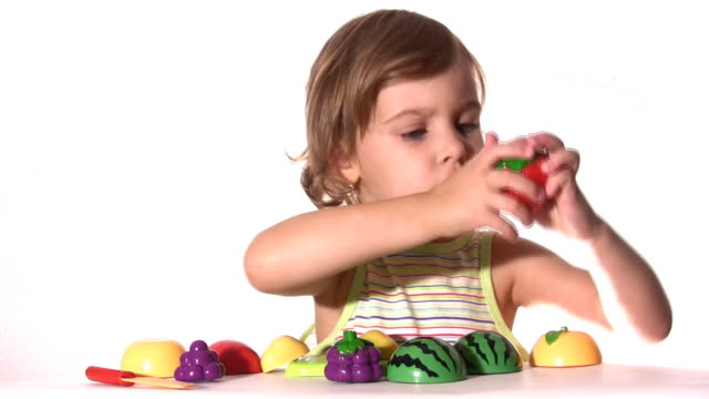 Little girl with plastic fruits video