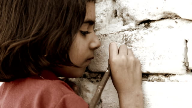 Little Girl Writing on Wall video