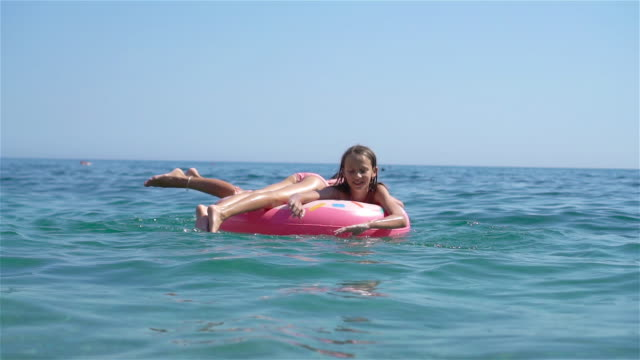 little girls having fun at tropical beach during summer vacation playing together - wschodnio europejski filmów i materiałów b-roll