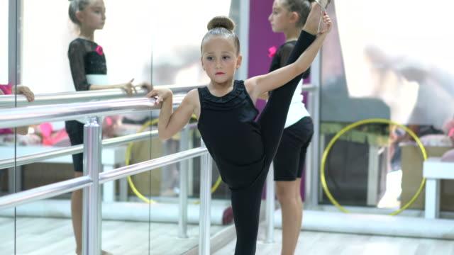 Little Girls Preparing for Ballet Training Indoors Little Girls Preparing for Ballet Training Indoors doing the splits stock videos & royalty-free footage